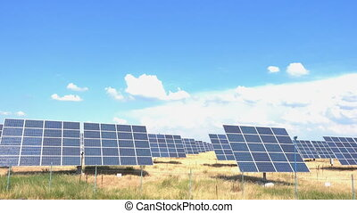 lot of solar panels standing at the field