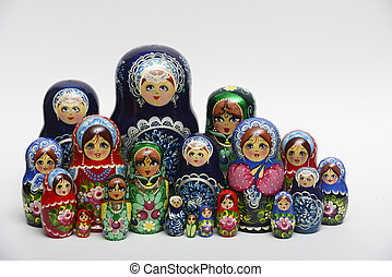 lot of traditional Russian nesting dolls on white