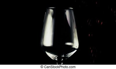 Lot of wine is pouring into the glass
