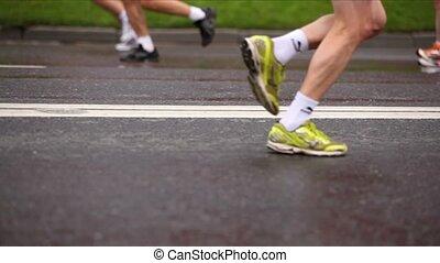 Lot people legs run on wet asphalt at XXX Moscow International Peace Marathon