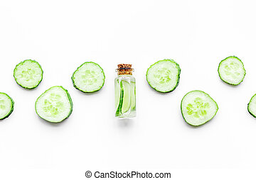 Lotion with cucumber pattern. White background top view copyspace