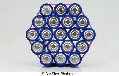 Lots of AA and AAA alkaline batteries on a white background. Ecological recycling concept. The terminals of the disposable batteries are close together and form a beautiful backdrop. Energy source.