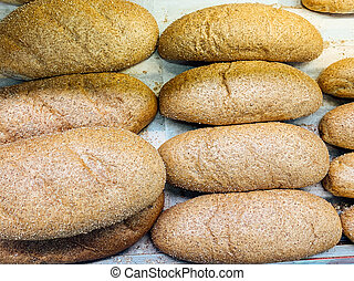 lots of baked fresh bread for eating on the table as the background