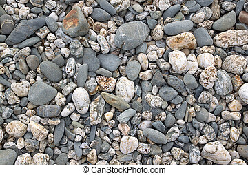 Lots of beach stones close up.
