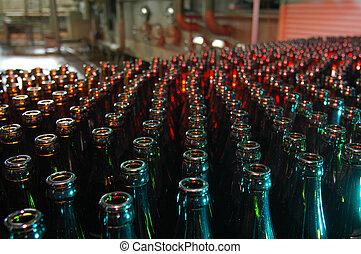 lots of beer bottles in a brewery