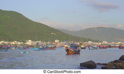 Lots of big fisherman boats in the port in Asia. Overfishing concept.