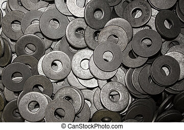 Lots of big industrial steel washers on a pile