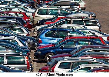Lots of cars parking in the city