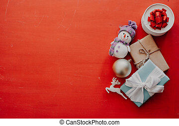 lots of christmas presents for Christmas and new year on the red background