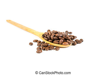 Lots of coffee beans. Closeup. Wooden spoon. Isolated.