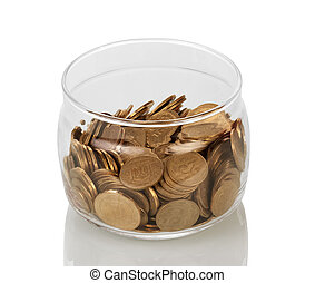 Lots of coins collected in glass jar isolated on white