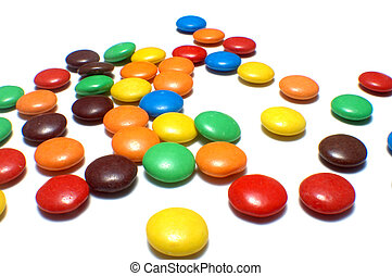 colorful candies - lots of colorful candies spread on white...