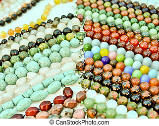 lots of colorful glass and stone beads  close up