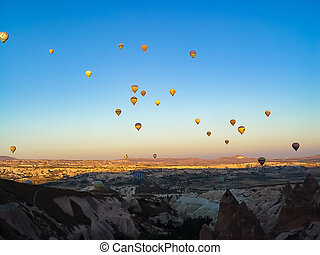 Lots of colorful hot air balloons flying over Cappadocia