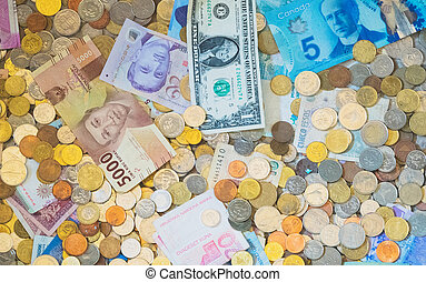 Lots of different money. Banknotes and coins.
