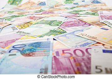Lots of euro banknotes scattered over the table