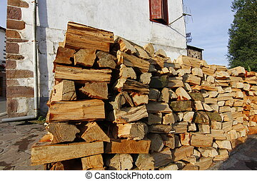 lots of firewood for fireplace stacked in the street
