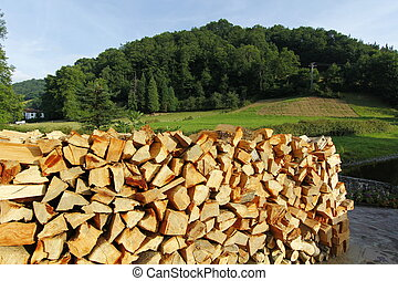 lots of firewood for fireplace stacked in the street - lots...