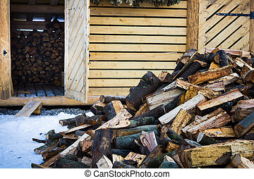 Lots of firewood lying on the street