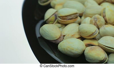 Lots of fried pistachios . On a white background.