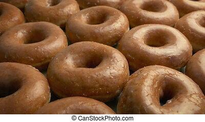 Lots Of Glazed Donuts - Moving slowly over tasty glazed...