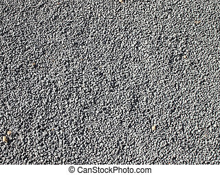 Lots of little gray gravel rocks with a couple of brown ...