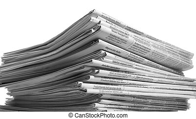 lots of newspapers - lots of stacked newspapers in light...