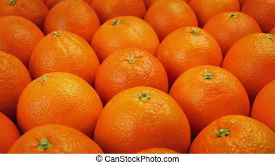 Lots Of Oranges Moving Shot - Slowly moving past many...
