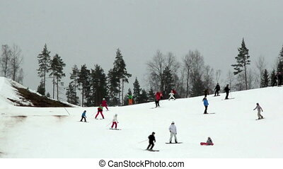 Lots of people are skiing on the resort