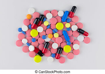 Lots of pills on a white background. Top view.