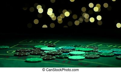 Lots of poker chips falling on casino table in slow-mo, lucky winner at casino. Close up. Slow motion