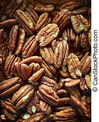 Lots of raw organic pecan nuts. Pecan background. Healthy...
