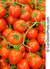 Lots of red tomatoes in supermarket