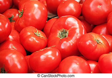 Lots of red tomatoes in supermarket.