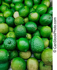 lots of ripe green sour limes for eating as a background