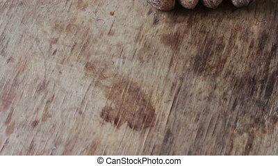 ripe walnuts in a peel - Lots of ripe walnuts in a peel on a...