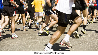 Lots of running people in a sports race