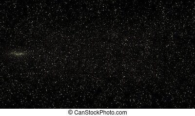 Lots of shiny stars in gold color movement on black background