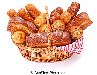 Lots of sweet bakery products in basket, white background