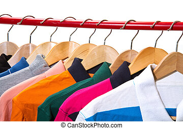 Lots of T-shirts on hangers