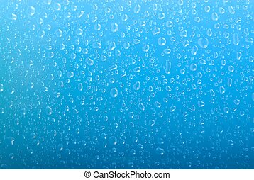 water drops on gradient blue background - lot's of water ...