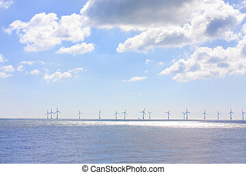 lots of wind turbines in a row