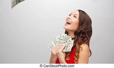 happy woman in red dress with us dollar money - lottery and...