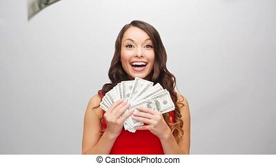 happy woman in red dress with us dollar money