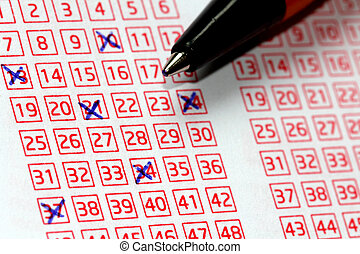 Lotto Lucky Numbers - Pen and lucky numbers marked on a...