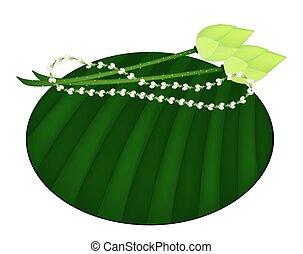Lotus and Jasmine Garland on Green Banana Leaf - Jasmine...