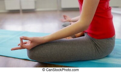Lotus Legs - Close-up of a woman keeping a lotus pose while...