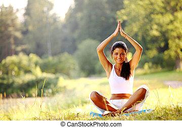 yoga attractive woman on beach doing yoga poses