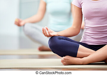 Lotus - Young people do yoga indoors