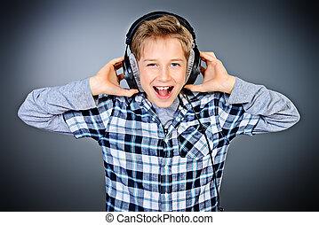 loud music - Cheerful teen boy listening to music in ...